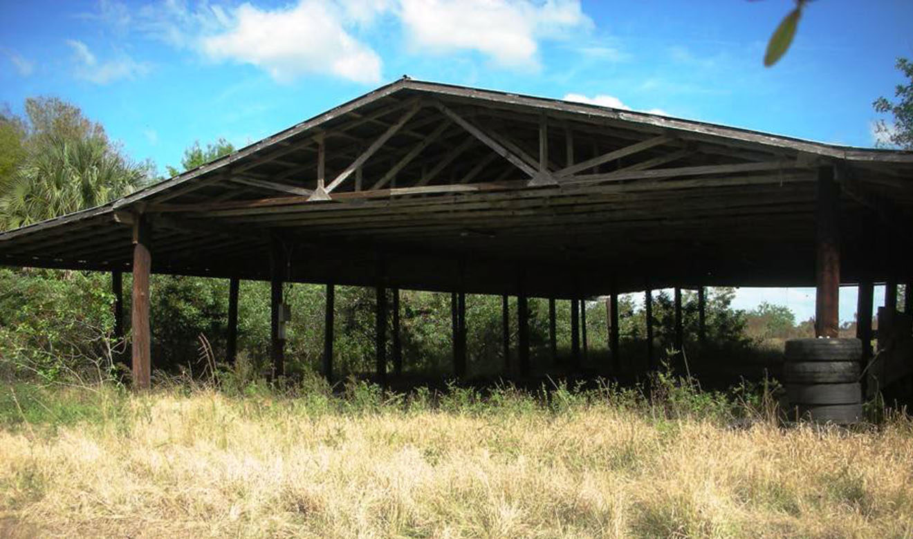 Large wooden pole barn close to cow pens